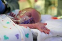 A new molecule is found to prevent preterm birth. Image does not depict child involved in study