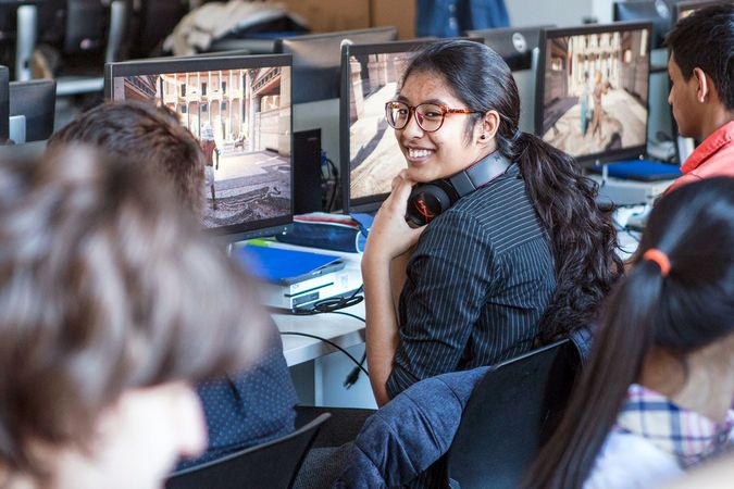 A student takes a break from the Assassin's Creed: Origins interactive 'Discovery Tour' at Collège Jean-de-Brébeuf, in Montreal.