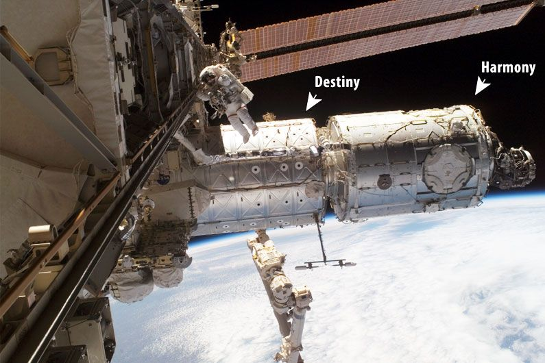 NASA astronaut Peggy Whitson walks in space outside the Destiny and Harmony modules of the International Space Station.